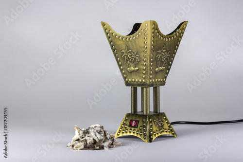 Fényképezés Golden censer incense burner isolated on white background