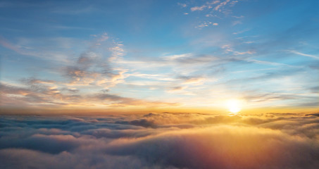Beautiful aerial view above clouds with sunset