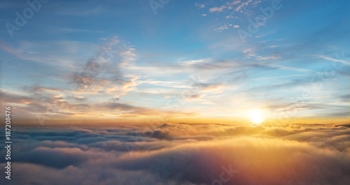 Spoed Foto op Canvas Zonsondergang Beautiful aerial view above clouds with sunset