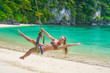 Beautiful woman is relaxing on Papaya beach in El Nido bay, Philippines