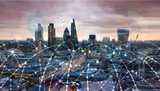 Fototapeta Londyn - City of London at sunset. Illustration with communication and business icons, network connections concept.