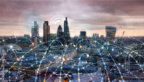 Photo sur Toile Batiment Urbain City of London at sunset. Illustration with communication and business icons, network connections concept.
