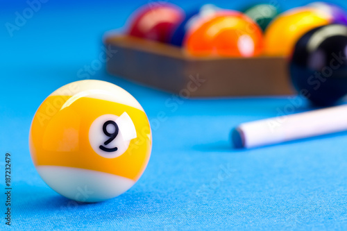 Fototapeta  Billiard pool game nine ball with cue on billiard table