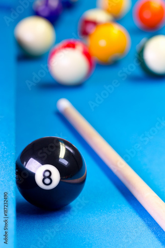 Fototapeta Billiard pool game eight ball with cue on billiard table
