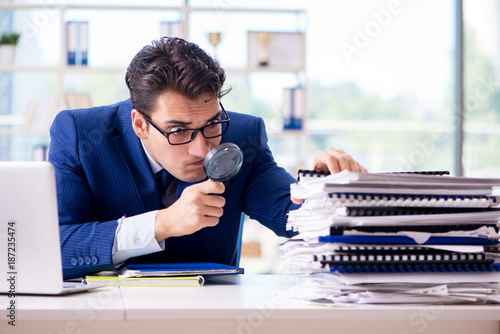 Auditor looking for errors in the financial statements Canvas Print