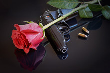Rose, Gun And Two Bullets On B...