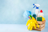 Spring cleaning concept with supplies, house cleaning products pile. Household chore concept, on light blue background copy space