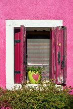 Italy, Venice, Burano Island. Traditional Colorful Walls And Windows Of The Old Houses. Copy Space