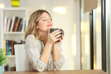Woman Breathing Holding A Coff...
