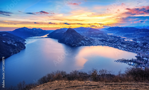 Fototapeta Dramatic sunset over Lake Lugano in swiss Alps, Switzerland