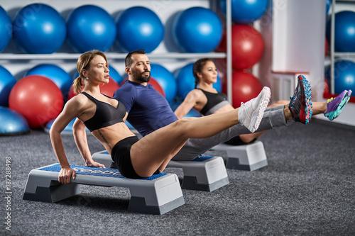 Fotografie, Obraz  Fitness team doing abs crunches