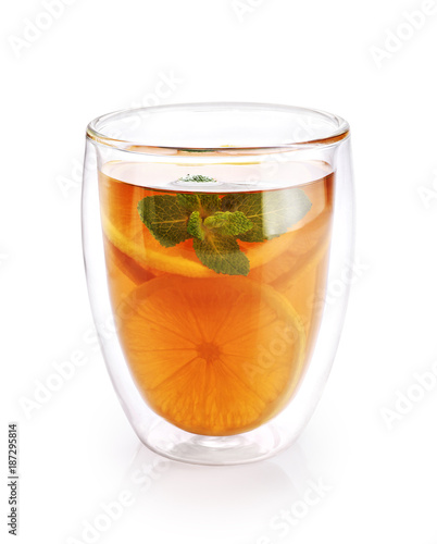 Foto op Aluminium Thee Hot tea with mint and lemon in a glass with double walls isolated on white background.