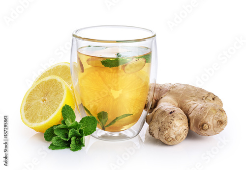 Keuken foto achterwand Thee Hot tea with mint, lemon and ginger in a glass with double walls isolated on white background.