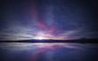 idyllic sunrise in the sky reflecting on calm water