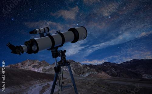 Fototapeta telescope on a tripod pointing at the night sky obraz