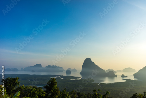 Foto op Aluminium Strand Scenic viewpoint of Phang Nga Bay from Semet Nang She mountain with silhouette island and mountain with morning sunlight.