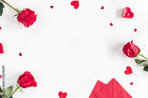Obraz Valentine's Day. Frame made of rose flowers, gifts, candles, confetti on white background. Valentines day background. Flat lay, top view, copy space - fototapety do salonu