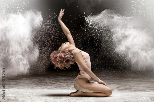 Beautiful dancer performing in dust.