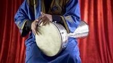 Arabic Percussionist Playing The Rhythm Beladi On The Duhulla Or Bass Doumbek.