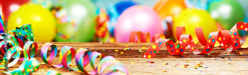Panoramic party banner with balloons and streamers