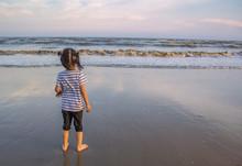 Asian Little Girl Standing On ...