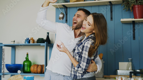 Joyful Couple Have Fun Dancing And Singing In The Kitchen At Home In The Morning Stock Photo Adobe Stock