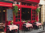 Fototapeta Paris - Cozy street with tables of cafe in Paris, France