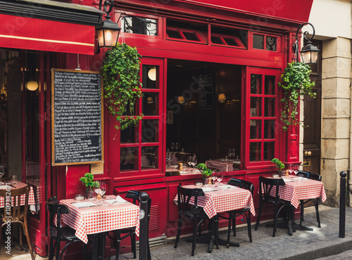 Fotografie, Tablou Cozy street with tables of cafe in Paris, France