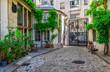 canvas print picture - Cozy street in Paris, France