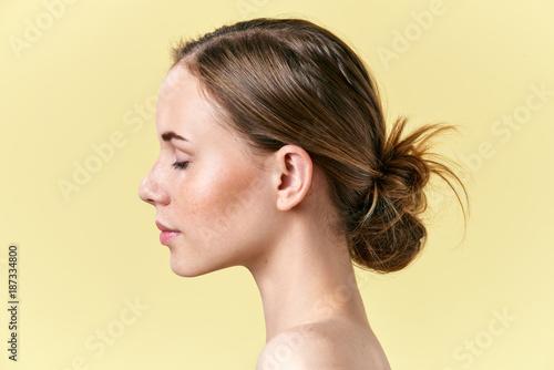 Cuadros en Lienzo Beautiful redhead woman with freckles studio profile portrait