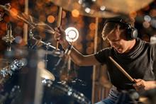 Male Musician Playing Drum Kit...