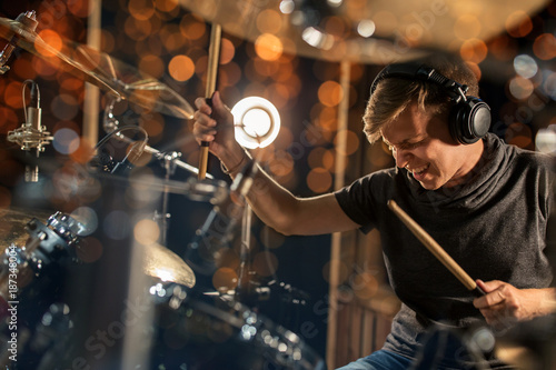 male musician playing drum kit at concert - 187348004