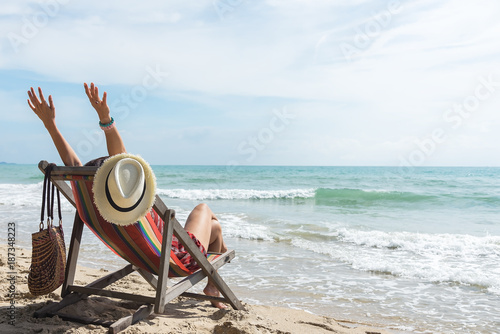 Canvas Print happy woman with open arms enjoying the summer sea vacation