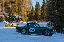 Vintage Racing Car Driving Classic Rally On Snow Covert Road