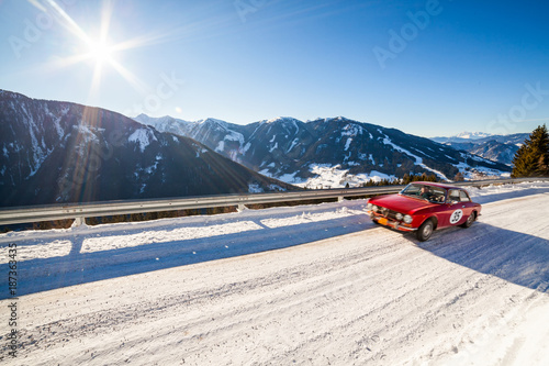 Fotobehang Vintage cars Vintage racing car driving classic rally on snow covert road