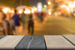 Empty wooden table of brown and black vintage on front blurred night walk street background, mock up for presentation product, template