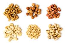 Six Types Of Walnut, Hazelnut, Peanut, Cashew, Pine And Pistachios On A White Background.