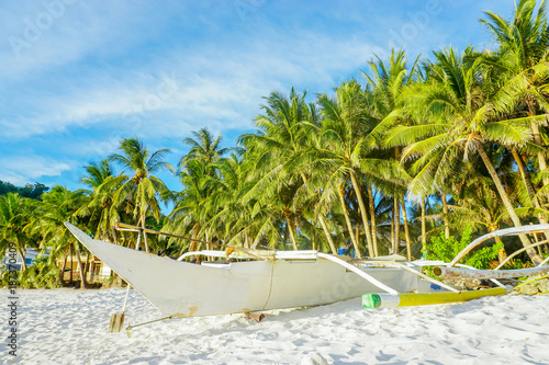 Spoed Foto op Canvas Natuur Boat on a tropical white sand beach with palm trees and blue sky, Phillippines Boracay