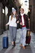male and female in the historic center with baggage