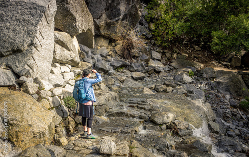 Yosemite Hiker Looks at Trail Ahead - Buy this stock photo and