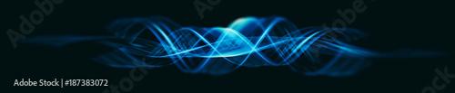 Valokuva  Glow swirl light effect. Magic ribbon isolated on black