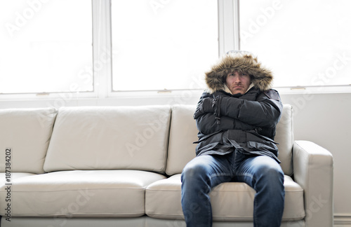 Man With Warm Clothing Feeling The Cold Inside House on the sofa Fototapeta