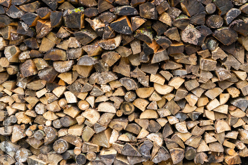 Tuinposter Brandhout textuur Pile firewood prepared for fireplace. Kiln-dried firewood background.
