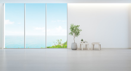 FototapetaIndoor plant on wooden floor and minimal furniture with empty white wall background, Lounge in sea view living room of modern luxury beach house or hotel - Home interior 3d illustration