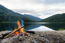 Landscape Of A Campfire In A Peaceful Lake Valley.
