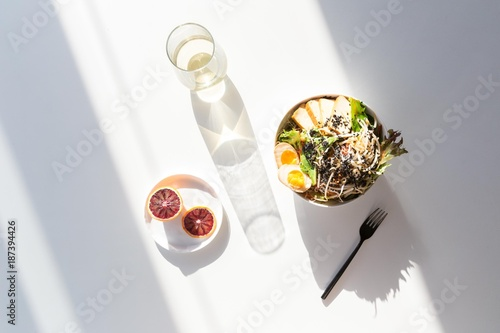 Salad with blood oranges and drink in sunlight