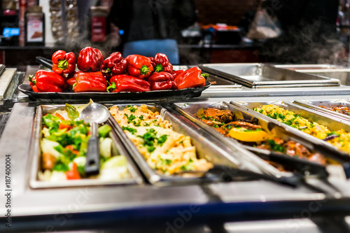 Fotografie, Obraz  Buffet bar and trays with roasted salad vegetables, red bell peppers and meat di