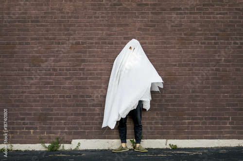 Poster Man in Halloween Ghost Costume Made of Torn Bedsheets
