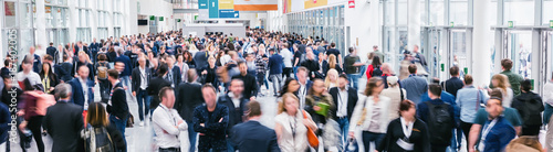 Fototapeta large crowd of anonymous blurred people at a trade show obraz