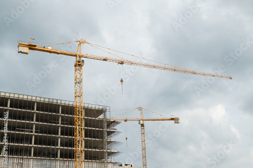 Construction site with cranes and building under construction